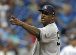 FILE - In this Sept. 27, 2018, file photo, New York Yankees' CC Sabathia points at the Tampa Bay Rays dugout after he was ejected for hitting Tampa Bay Rays' Jesus Sucre with a pitch during the sixth inning of a baseball game, in St. Petersburg, Fla. The New York Yankees gave pitcher CC Sabathia a $500,000 performance bonus, even though the 38-year-old left-hander was ejected from his final regular-season start six outs shy of the 155 innings specified for the payment in his contract. (AP Photo/Chris O'Meara, File)