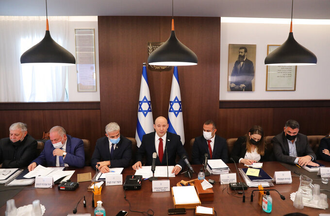 Israeli Prime Minister Naftali Bennett attends a cabinet meeting at his office in Jerusalem, Sunday, Aug. 1, 2021. (Abir Sultan/Pool Photo via AP)