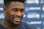 Seattle Seahawks rookie wide receiver DK Metcalf talks to reporters, Monday, July 29, 2019, during NFL football training camp in Renton, Wash. (AP Photo/Ted S. Warren)