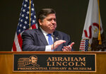 Illinois Gov. JB Pritzker acknowledges everyone involved in passing legislation marking Juneteenth an official state holiday in Illinois during a bill signing ceremony at the Abraham Lincoln Presidential Library, Wednesday, June 16, 2021, in Springfield, Ill. (Justin L. Fowler/The State Journal-Register via AP)