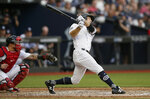 New York Yankees' Brett Gardner hits a two-run home run against the Boston Red Sox during the third inning of a baseball game, Saturday, June 29, 2019, in London. Major League Baseball made its European debut game today at London Stadium. (AP Photo/Tim Ireland)
