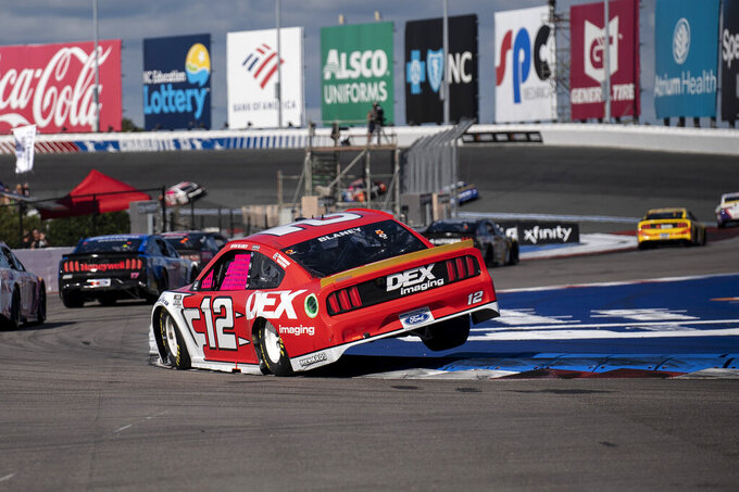 Ryan Blaney (12) competes during a NASCAR Cup Series auto racing race at Charlotte Motor Speedway, Sunday, Oct. 10, 2021, in Concord, N.C. (AP Photo/Matt Kelley)