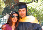 In this photo provided by the family of Abdulrahman al-Sadhan, Abdulrahman al-Sadhan poses with his sister Areej Al Sadhan for a graduation photo, at Notre Dame de Namur University, a private Catholic university, in Belmont, California, May 4, 2013. Saudi humanitarian aid worker Abdulrahman al-Sadhan's anonymous Twitter account used to parody issues about the economy in Saudi Arabia has landed him in prison in the kingdom. But his story may have roots in an elaborate ploy that began in Silicon Valley and sparked a federal case against two Twitter employees accused of spying for the kingdom. (Family of Abdulrahman al-Sadhan via AP)