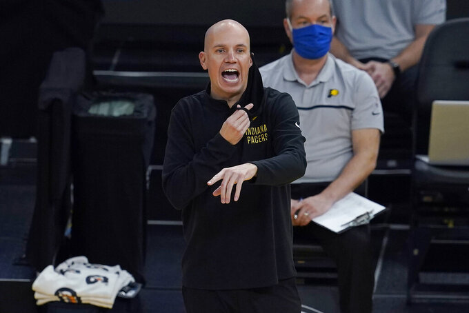 Indiana Pacers coach Nate Bjorkgren yells during the first half of the team's NBA basketball game against the Golden State Warriors in San Francisco, Tuesday, Jan. 12, 2021. (AP Photo/Jeff Chiu)