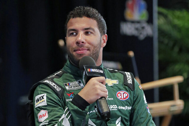 FILE - In this Feb. 12, 2020, file photo, Bubba Wallace takes part in an interview during NASCAR Daytona 500 auto racing media day at Daytona International Speedway in Daytona Beach, Fla. Corporate interest in Bubba Wallace has picked up momentum and NASCAR's only black full-time driver has signed a new sponsor that includes funding for his Richard Petty Motorports team. Columbia Sportswear signed a multiyear sponsorship with Wallace as a brand ambassador that will also put the company on the No. 43 at Dover later this month. (AP Photo/John Raoux)