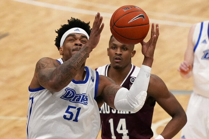 Drake's Darnell Brodie (51) reaches for a rebound as Missouri State's Keaton Hervey (14) watches during the first half of an NCAA college basketball game in the semifinal round of the Missouri Valley Conference men's tournament Saturday, March 6, 2021, in St. Louis. (AP Photo/Jeff Roberson)