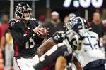 Atlanta Falcons quarterback Feleipe Franks (15) works against the Tennessee Titans during the second half of a preseason NFL football game, Friday, Aug. 13, 2021, in Atlanta. (AP Photo/Brynn Anderson)