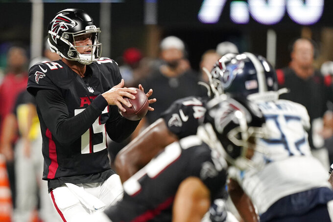 Woodside, Barkley throw TDs as Titans stop Falcons 23-3