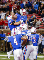 SMU tight end Ryan Becker (14) is congratulated by teammates after scoring a touchdown during the first half of an NCAA college football game against Houston, Saturday, Nov. 3, 2018, in Dallas. (AP Photo/Brandon Wade)