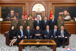 In this Friday, April 12, 2019, photo provided by the North Korean government, North Korean leader Kim Jong Un, front center, poses with the newly-elected members of the leadership bodies of the Workers' Party of Korea and state in Pyongyang, North Korea. Independent journalists were not given access to cover the event depicted in this image distributed by the North Korean government. The content of this image is as provided and cannot be independently verified. Korean language watermark on image as provided by source reads: