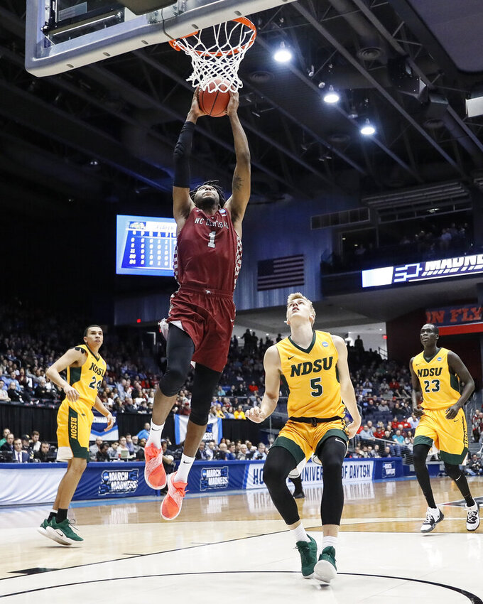 NC Central's Zacarry Douglas (1) dunks as North Dakota State's Sam Griesel (5) watches during the first half of a First Four game of the NCAA college basketball tournament, Wednesday, March 20, 2019, in Dayton, Ohio. (AP Photo/John Minchillo)