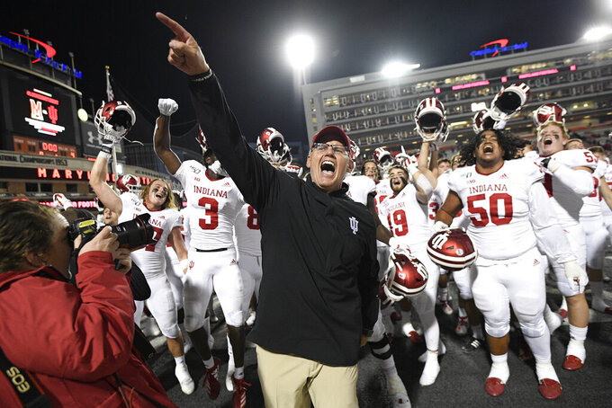 Indiana head coach Tom Allen, center, celebrates with his team after an NCAA college football game against Maryland, Saturday, Oct. 19, 2019, in College Park, Md. (AP Photo/Nick Wass)