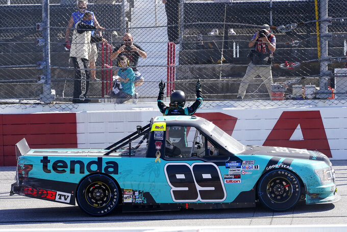 Ben Rhodes (99) celebrates after a win after a NASCAR Truck race Sunday, Sept. 6, 2020, in Darlington, S.C. (AP Photo/Chris Carlson)
