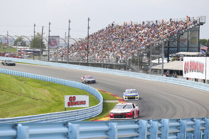 Erik Jones (43) and Chase Elliott (9) turn to the Esses during a NASCAR Cup Series auto race in Watkins Glen, N.Y., on Sunday, Aug. 8, 2021. (AP Photo/Joshua Bessex)