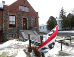 This Friday, Nov. 29, 2019 shows the exterior of the Saranac Laboratory Museum and home, right, of tuberculosis pioneer Dr. Edward Livingston in Saranac Lake, N.Y. An Adirondack Mountain village that was put on the map as a cure center for tuberculosis is honoring its novel legacy. Saranac Lake, New York, was once a mini-metropolis of medical care, but the boom ended with the rise of antibiotics. Now, a local history group has purchased the old home and medical office of a treatment pioneer for museum space. And developers bought his old sanitorium with plans to refurbish and reuse it. (AP Photo/Hans Pennink)