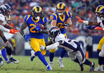 Los Angeles Rams running back Darrell Henderson, left, runs against the Denver Broncos during the first half of an NFL preseason football game Saturday, Aug. 24, 2019, in Los Angeles. (AP Photo/Mark J. Terrill)