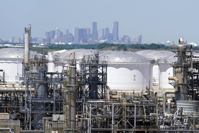 In this Thursday, April 30, 2020, photo storage tanks at a refinery along the Houston Ship Channel are seen with downtown Houston in the background. Like in other cities, the coronavirus has shut down much of Houston's economic activity, slashing thousands of jobs, while at the same time, the price of oil plunged below zero recently as demand plummeted due to the worldwide lockdown to stop the spread of the virus. This one-two punch from COVID-19 and the collapse in oil prices will make it much harder for Houston to recover from a looming recession, according to economists. (AP Photo/David J. Phillip)
