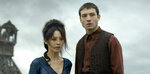 This image released by Warner Bros. Pictures shows Claudia Kim, left and Ezra Millerin a scene from