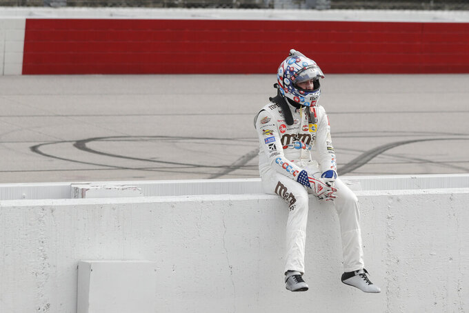 Kyle Busch sits on the pit wall after finishing second to Chase Briscoe in the NASCAR Xfinity series auto race Thursday, May 21, 2020, in Darlington, S.C. (AP Photo/Brynn Anderson)