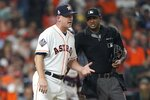 Houston Astros manager AJ Hinch argues a call with home plate umpire Alan Porter during the fourth inning of Game 1 of the baseball World Series against the Washington Nationals Tuesday, Oct. 22, 2019, in Houston. (AP Photo/David J. Phillip)