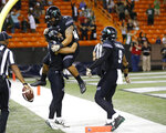 Hawaii wide receiver Cedric Byrd (6) celebrates with teammates running back Dayton Furuta (7) and wide receiver Devan Stubblefield (9) after he made the game winning touchdown against UNLV during the fourth quarter of an NCAA college football game, Saturday, Nov. 17, 2018, in Honolulu. Hawaii defeated UNLV 35-28. (AP Photo/Marco Garcia)