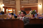 Republican Rep. Will Mortensen listens to debate in the South Dakota House on Tuesday, Feb. 23, 2021, in South Dakota/Capital in Pierre, S.D., after he sponsored a resolution to impeach Attorney General Jason Ravnsborg. The state's top law enforcement officer is facing misdemeanor charges for striking and killing a man with his car. (AP Photo/Stephen Groves)