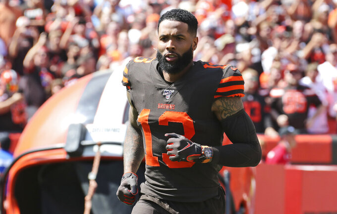 "FILE - In this Sunday, Sept. 8, 2019, file photo, Cleveland Browns wide receiver Odell Beckham Jr. is introduced as he runs out on the field before an NFL football game against the Tennessee Titans, in Cleveland. Odell Beckham Jr. says former Browns defensive coordinator Gregg Williams instructed his players to ""take me out"" of a preseason game in 2017. The Pro Bowl wide receiver sustained an ankle injury when Cleveland's Briean Boddy-Calhoun cut his legs out while he was with the New York Giants. Beckham said current Cleveland players told him that Williams instructed them to ""take me out of the game, and it's preseason."" (AP Photo/Ron Schwane, File)"