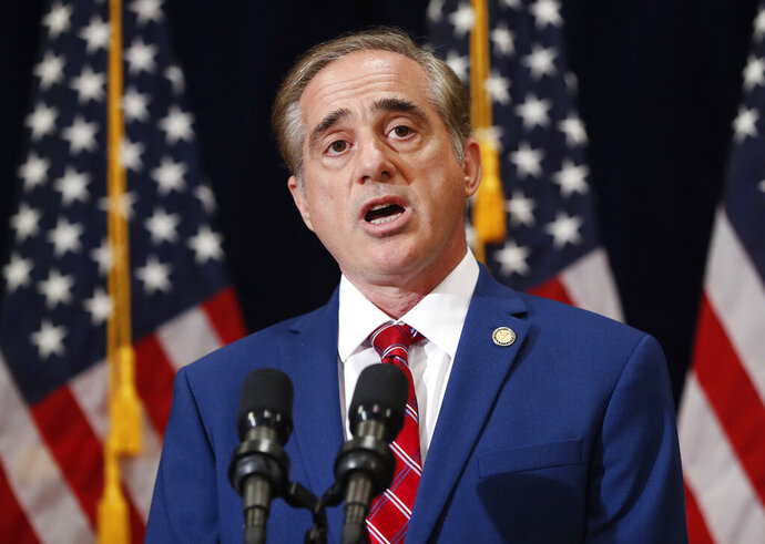 FILE - In tjhis Aug. 2017 file photo then Veterans Affairs Secretary David Shulkin speaks during a press briefing in Bridgewater, N.J. The book by former VA Secretary David Shulkin, obtained by The Associated Press, describes a March 6, 2017, conversation in the Oval Office where the president explored ways in which the administration could act quickly in shuttering the government-run VA medical centers that he viewed as poorly performing. (AP Photo/Pablo Martinez Monsivais)