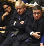 Britain's Prime Minister Boris Johnson, center, sits on the government front bench in the House of Commons in London following the debate for the EU Withdrawal Agreement Bill, Tuesday Oct. 22, 2019. British lawmakers have rejected the government's fast-track attempt to pass its Brexit bill within days, demanding more time to scrutinize the complex legislation and throwing Prime Minister Boris Johnson's exit timetable into chaos. (Jessica Taylor, UK Parliament via AP)