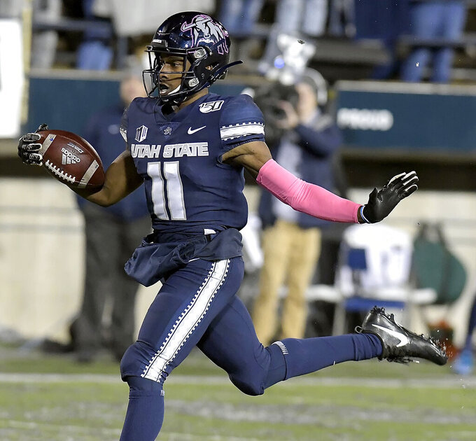 Utah State's Savon Scarver (11) celebrates as he returns a kickoff 100 yards for a touchdown against Nevada during an NCAA college football game Saturday, Oct. 19, 2019, in Logan, Utah. (Eli Lucero/The Herald Journal via AP)