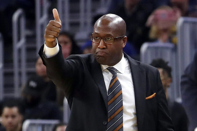 FILE - In this Nov. 4, 2019, file photo, Golden State Warriors assistant coach Mike Brown gestures during an NBA basketball game against the Portland Trail Blazers in San Francisco. Brown is the coach of the Nigerian men's Olympic basketball team this summer, and that team starts preparations for the Tokyo Games with training camp beginning this weekend in Oakland, Calif. (AP Photo/Jeff Chiu, File)