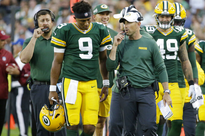 Green Bay Packers quarterback DeShone Kizer (9) talks on the sideline with coach Matt LaFleur during the first half of the team's NFL preseason football game against the Houston Texans on Thursday, Aug. 8, 2019, in Green Bay, Wis. (AP Photo/Mike Roemer)