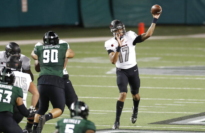UNLV quarterback Doug Brumfield (17) throws a pass against Hawaii during the first half of an NCAA college football game Saturday, Dec. 12, 2020, in Honolulu. (AP Photo/Marco Garcia)