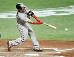 Boston Red Sox's Christian Vazquez hits a RBI-single off Tampa Bay Rays starter Ryan Yarbrough during the sixth inning of a baseball game Wednesday, Aug. 5, 2020, in St. Petersburg, Fla. (AP Photo/Steve Nesius)