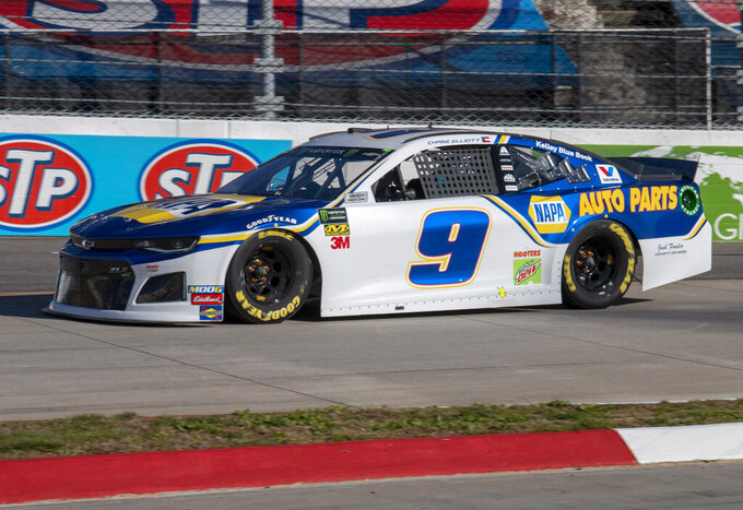 Chase Elliott races for position during qualifying for the NASCAR Monster Energy Cup Series race at Martinsville Speedway in Martinsville, Va., Saturday, March 23, 2019. (AP Photo/Matt Bell)