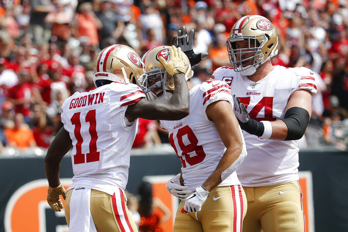 San Francisco 49ers wide receiver Marquise Goodwin (11) celebrates his touchdown with wide receiver Dante Pettis (18) during the first half an NFL football game against the Cincinnati Bengals, Sunday, Sept. 15, 2019, in Cincinnati. (AP Photo/Frank Victores)
