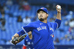 Toronto Blue Jays starting pitcher Hyun Jin Ryu throws to a Baltimore Orioles batter during the first inning of a baseball game Tuesday, Aug. 31, 2021, in Toronto. (Jon Blacker/The Canadian Press via AP)