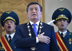 FILE - In this file photo taken on Friday, Nov. 24, 2017, President-elect Sooronbai Jeenbekov sings the national anthem during the presidential inauguration ceremony in Bishkek, Kyrgyzstan. Kyrgyzstan President Sooronbai Jeenbekov announced his resignation on Thursday, Oct. 15, 2020 in a bid to end the turmoil that has engulfed the Central Asian nation after a disputed parliamentary election. In a statement released by his office, Jeenbekov, who has faced calls to step down from protesters and political opponents, said that holding on to power wasn't