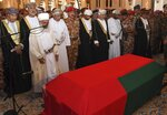 In this photo made available by Oman News Agency, Oman's new sultan Haitham bin Tariq Al Said, second from left of second row, attends the prayer ceremony for Sultan Qaboos' coffin at Sultan Qaboos Grand Mosque in Muscat, Oman, Saturday, Jan. 11, 2020. Sultan Qaboos bin Said, the Mideast's longest-ruling monarch who seized power in a 1970 palace coup and pulled his Arabian sultanate into modernity while carefully balancing diplomatic ties between adversaries Iran and the U.S., has died. He was 79. (Oman News Agency via AP)