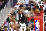 Washington Wizards guard Bradley Beal, top, passes the ball as Boston Celtics' Guerschon Yabusele, bottom left, and Jaylen Brown (7) defend during the first half of an NBA basketball game Tuesday, April 9, 2019, in Washington. (AP Photo/Nick Wass)