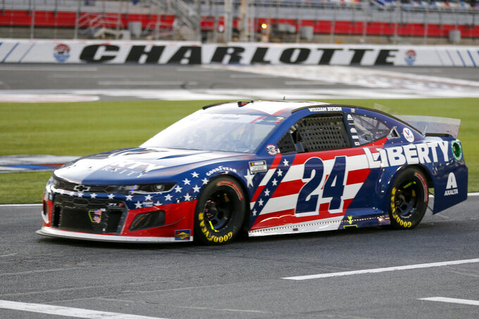 FILE - NASCAR Cup Series driver William Byron (24) drives down pit road during a NASCAR Cup Series auto race at Charlotte Motor Speedway in Concord, N.C., in this Sunday, May 30, 2021, file photo. Liberty University has reached a five-year extension with Hendrick Motorsports to continue as a primary sponsor for William Byron.  Byron is a junior pursuing a degree in strategic communication through Liberty University's online program. (AP Photo/Nell Redmond, File)