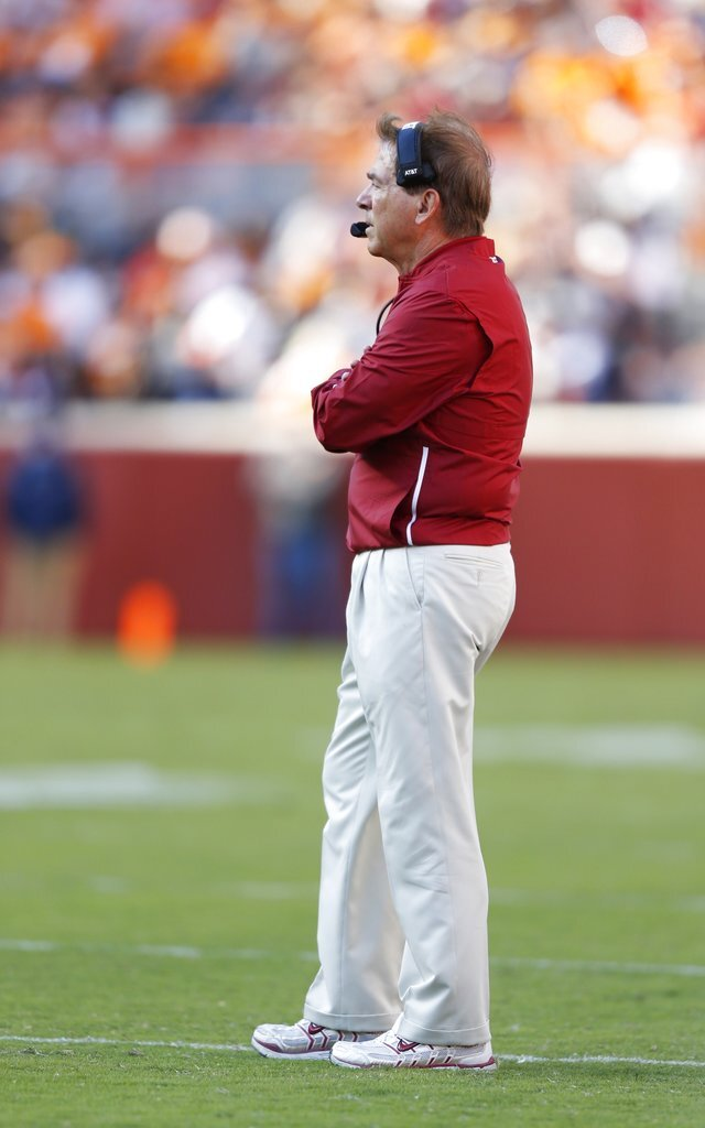 Alabama head coach Nick Saban stands on the field as he waits for a call to be made in the first half of an NCAA college football game against Tennessee Saturday, Oct. 20, 2018, in Knoxville, Tenn. (AP Photo/Wade Payne)