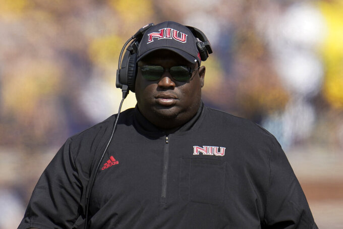 Northern Illinois head coach Thomas Hammock watches against Michigan in the first half of a NCAA college football game in Ann Arbor, Mich., Saturday, Sept. 18, 2021. (AP Photo/Paul Sancya)