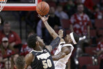 Nebraska's Glynn Watson Jr., right, goes for a layup against Purdue's Trevion Williams (50) during the first half of an NCAA college basketball game in Lincoln, Neb., Saturday, Feb. 23, 2019. (AP Photo/Nati Harnik)