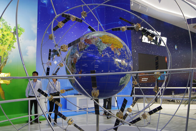 "FILE - In this Nov. 6, 2018, file photo,  a model of Chinese Beidou Navigation Satellite System is displayed during the 12th China International Aviation and Aerospace Exhibition, also known as Airshow China 2018, in Zhuhai city, south China's Guangdong province. Citing technical reasons, China has delayed the launch of the final satellite to complete its Beidou Navigation Satellite System constellation that emulates the U.S. Global Positioning System. The official Xinhua News Agency said Tuesday, June 16, 2020's mission aboard a Long March-3 rocket from the southwestern satellite launch base of Xicheng was scrubbed after pre-launch checks discovered ""product technical problems."" (AP Photo/Kin Cheung, File)"