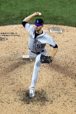 Colorado Rockies pitcher Daniel Bard throws in the fifth inning against the Texas Rangers in a baseball game Saturday, July 25, 2020, in Arlington, Texas. (AP Photo/Richard W. Rodriguez)