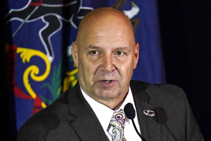 FILE - In this Nov. 25, 2020, file photo, state Sen. Doug Mastriano, R-Franklin, attends a hearing of the Pennsylvania State Senate Majority Policy Committee in Gettysburg, Pa.  Mastriano, who has talked of possibly running for governor of Pennsylvania in 2022, said Wednesday, May 19, 2021, that former President Donald Trump asked him to run and promised to campaign for him. (AP Photo/Julio Cortez, File)