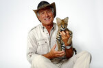 FILE - Wildlife advocate Jack Hanna poses for a portrait with a serval cub in New York on Oct. 12, 2015. The family of celebrity zookeeper and TV show host Jack Hanna said he's been diagnosed with dementia and will retire from public life. (Photo by Dan Hallman/Invision/AP, file)