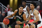 South Carolina Upstate guard Everette Hammond (12) tries to fight his way past the defense of Louisville forward Jordan Nwora (33) during the second half of an NCAA college basketball game in Louisville, Ky., Wednesday, Nov. 20, 2019. Louisville won 76-50. (AP Photo/Timothy D. Easley)