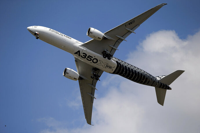 FILE - In this June 17, 2015 file photo, an Airbus A350 performs a demonstration flight at the Paris Air Show, in Le Bourget airport, north of Paris. European planemaker Airbus says it is taking the last step to end 16 years of litigation with the United States at the World Trade Organization. The manufacturer said it will end a system of financial support from France and Spain that the WTO had deemed illegal and unfair to rival Boeing. The Trump administration used the case as justification to slap tariffs on $7.5 billion worth of European exports. (AP Photo/Francois Mori, File)
